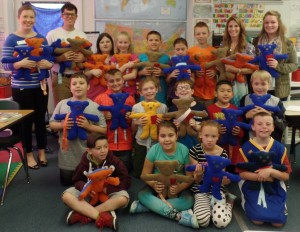 Mrs. Barry's students each holding the bear they stuffed!